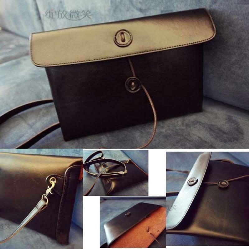 กระเป๋าสะพายหนัง สีดำ