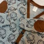 **H&M** เสื้อคลุมแขนยาวลายสิงโต ปักหนังสีน้ำตาลที่แขน